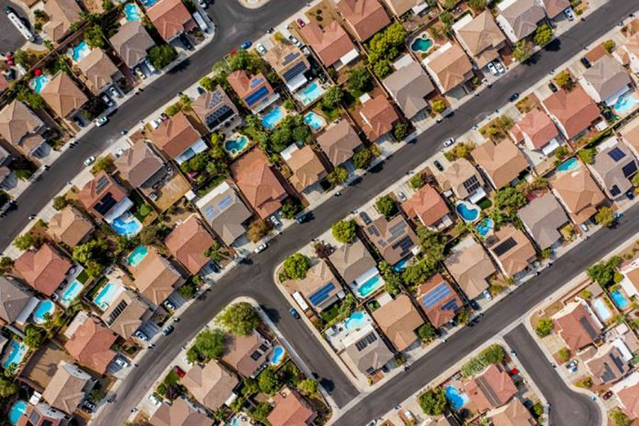 US existing home sales approach 14-year high; prices scale record peak